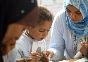 Students participate in an arts and crafts lesson at a school in the town of Abu Homous in the district of Damanhour